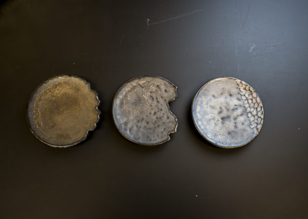 Golden reduction glaze on unique shaped saucers - By Studio RAW